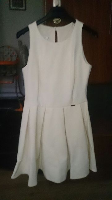 Rozkloszowana sukienka z kieszeniami S/M