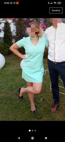 Miętowa sukienka z hokerem