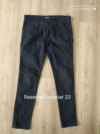 męskie czarne spodnie Reserved rurki rozmiar 33 L