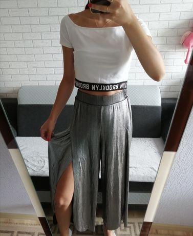 Nowe spodnie z rozcięciami r. L