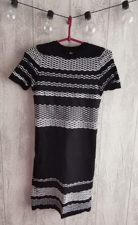 Sukienka w czarno białe paski Sinsay