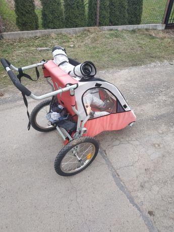 Przyczepka rowerowa z funkcją wózka