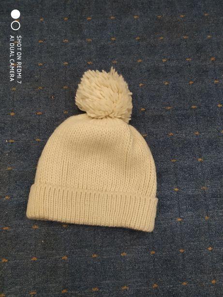 Продам женскую шапку next