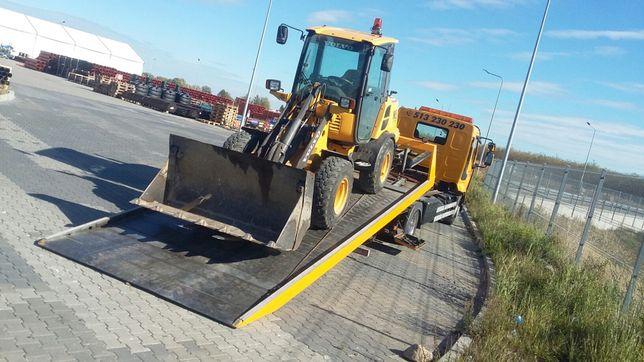 Transport maszyn budowlanych holowanie pomoc drogowa laweta
