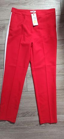 Nowe spodnie eleganckie czerwone