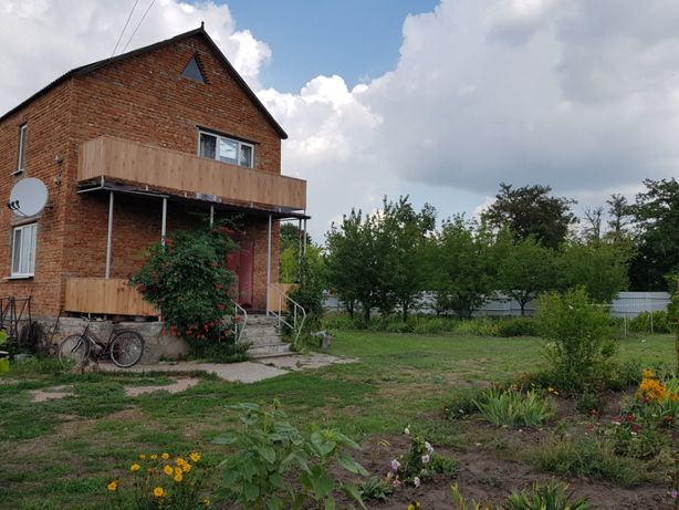 Продается двухэтажный дом с садом и огородом