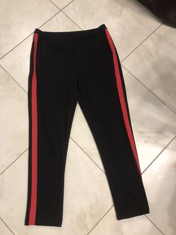 Spodnie czarne z czerwonym paskiem 38