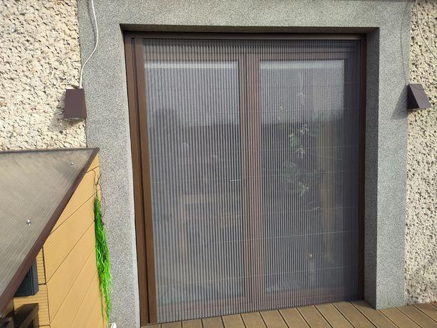 Moskitiery okienne, drzwiowe, plisowane, rolowane, producent, pomiar