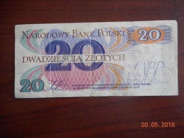banknot 20 zł z napisem wrona nas nie pokona