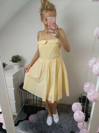 Rozkloszowana sukienka w paski L