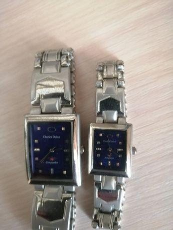 Чоловічий та жіночий годинник