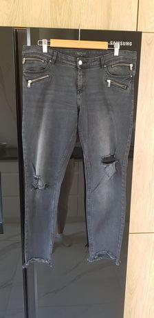 Czarne jeansy z dziurami 42 mohito