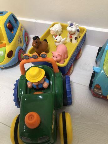 Продам трактор kiddielend ,автошку ,машинки tolo и кольцо для мяча