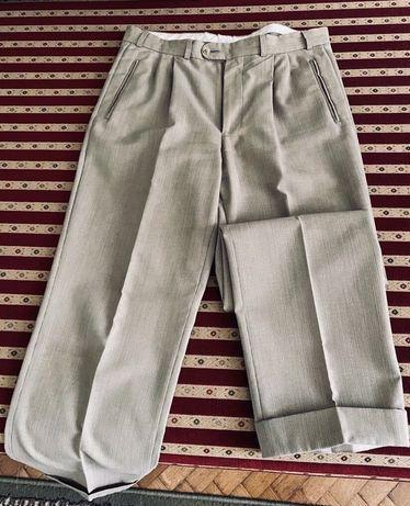 Spodnie beżowe eleganckie. Wzrost 182 cm.