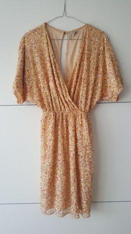 Sprzedam sukienkę marki H&M w rozm 36. Sukienka ubrana kilka razy.