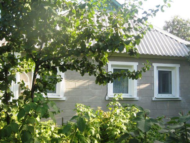 Продам дом в Перевальске с гаражом, летней кухней, садом и огородом