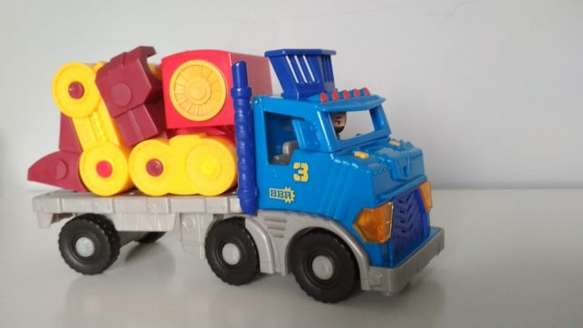 Fisher Price Imaginext Grand camion et robot + figurine chef d'orchestre.