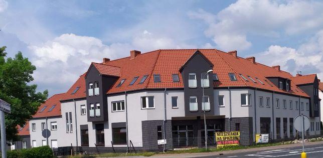 Blok 26 mieszkań i 5 lokali usługowych