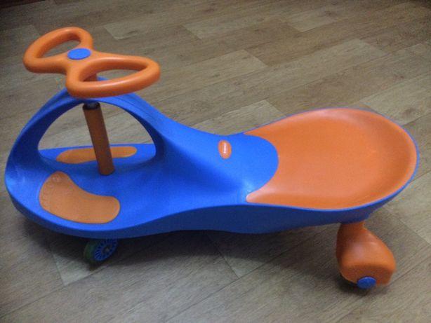 Дитяча інерційна машинка-каталка