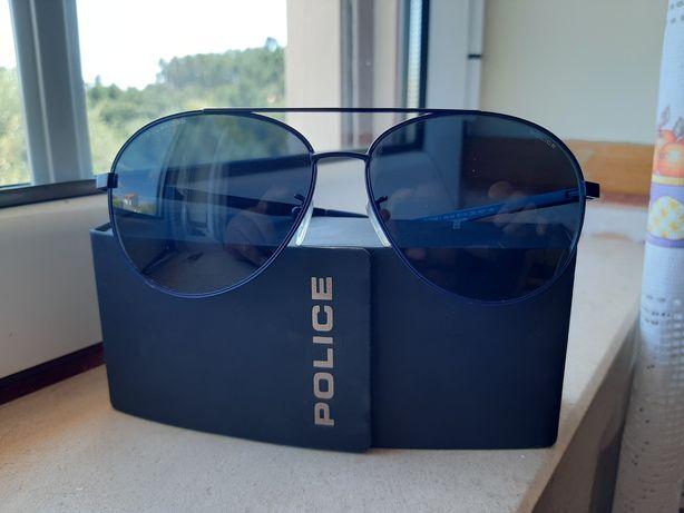 Oculos sol azuis marca police.