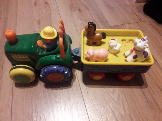 Traktor Dumel gra, jezdzi, swieci, na baterie
