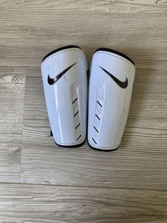Caneleiras Nike em ótimo estado