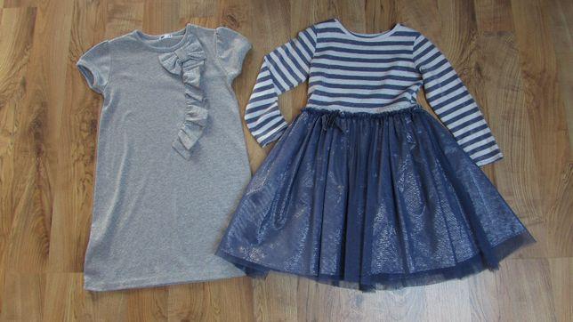 Dwie sukienki r. 122 eleganckie połyskujace srebrem jak nowe