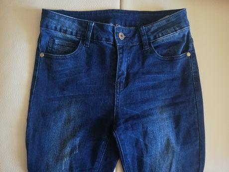 Spodnie jeansy Moodo 36