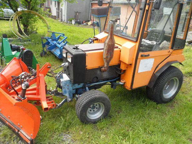 Traktorek wielofunkcyjny Holder w zestawie od firmy,stan bardzo dobry
