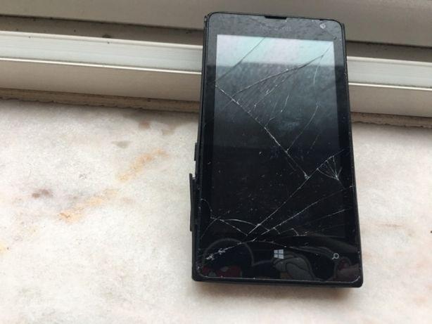 Lumia avariado , para peças , com carregador a funcionar