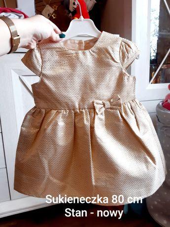 Złota elegancka piękna sukienka 80 cm