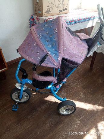 дитячий триколісний велосипед з ручкою
