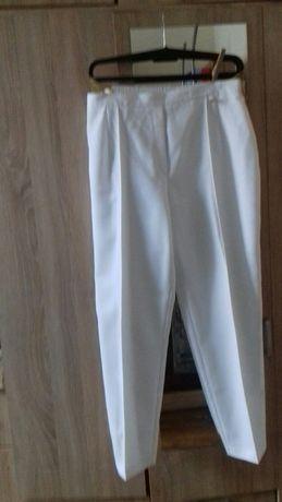 Nowe spodnie damskie  kolor biały.