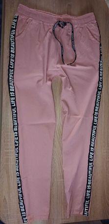 XL 42 40 OKAZJA Nowe spodnie Jeansy róż na gumie elastyczne Blogerskie