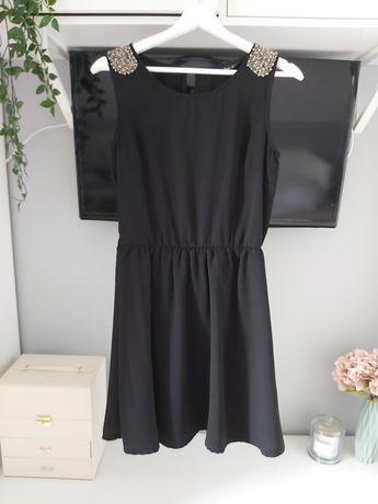Czarna sukienka House z koralikami rozm. M
