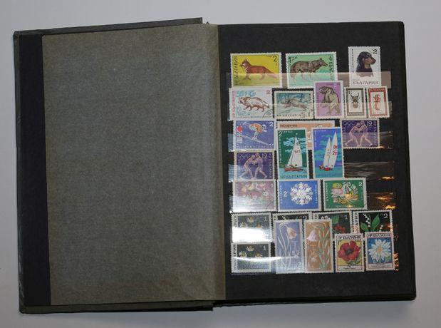 Duży klaser ze znaczkami międzynarodowymi i z różnych okresów