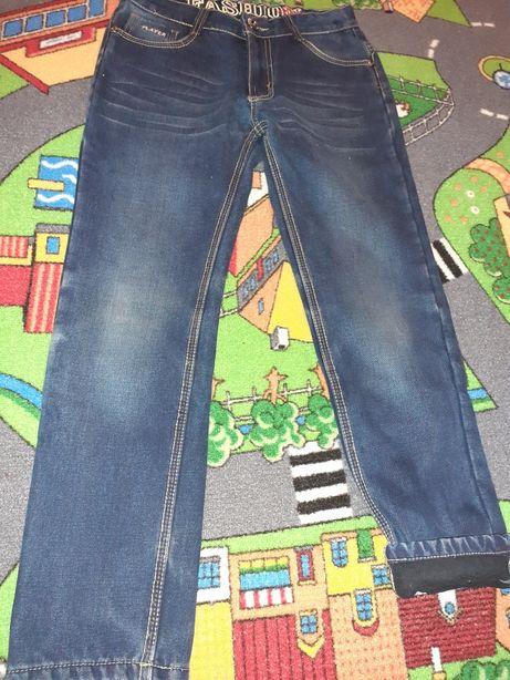 Spodnie 146 ocieplane