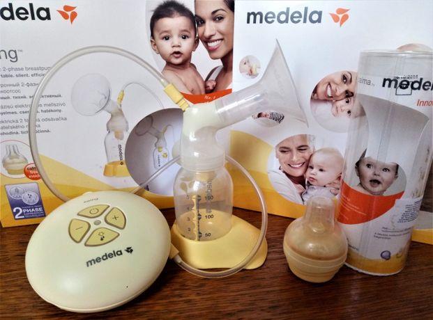 Двухфазный электрический молокоотсос Medela Swing + соска Calma