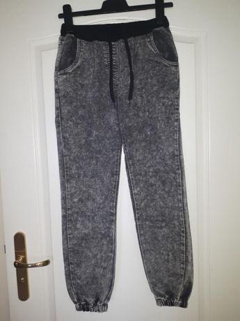 Spodnie marmurkowe wiązane w pasie, ściągacze przy nogawkach