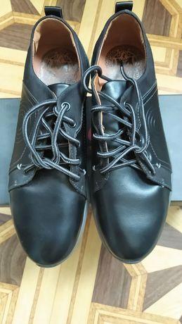 Новые туфли черного цвета