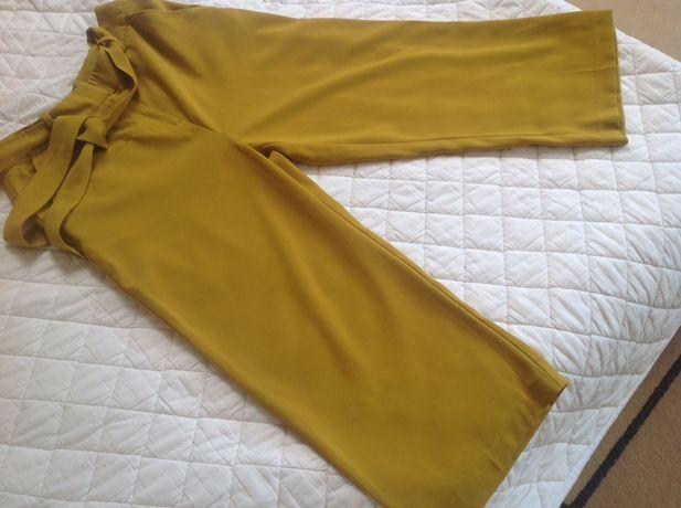 Musztardowe spodnie 3/4 r.S/36