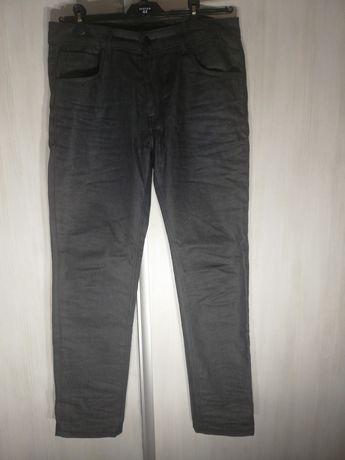 Spodnie jeansy Reserved nowe 34/34