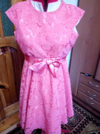 Красиве нарядне плаття рожево-персикового кольору для дівчинки