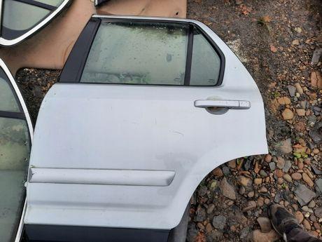 Drzwi lewe tylnie Honda CRV II LIFT 05-06r. NH623M