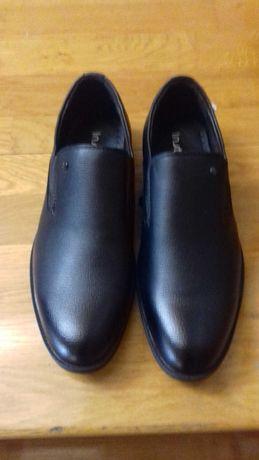 Продам новые мужские туфли