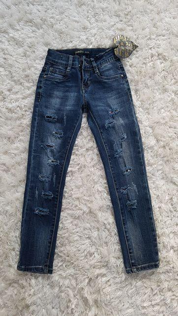 Nowe spodnie jeansowe z dziurami 122-128
