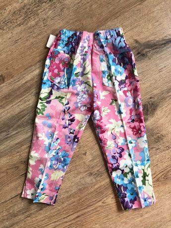 Nowe spodnie dziewczece na kant kwiaty 104