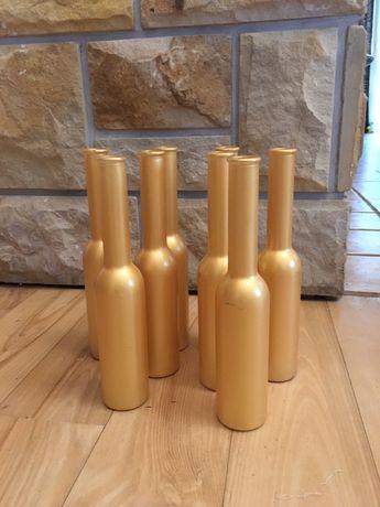 Sprzedam dekoracyjne butelki kolor złoty -17 szt.