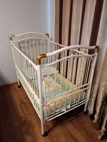 Дитяче ліжечко металеве