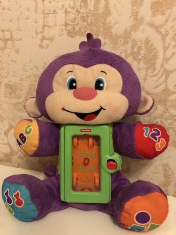 Музыкальная обезьяна Fisher price мягкая детская игрушка